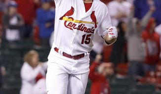 St. Louis Cardinals' Randal Grichuk celebrates after hitting a walk-off single to defeat the Chicago Cubs 4-3 in a baseball game Sunday, April 2, 2017, in St. Louis. (AP Photo/Jeff Roberson)