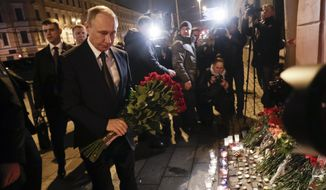Russian President Vladimir Putin laid flowers near a St. Petersburg subway station that was hit by a terrorist bombing on Monday. (Associated Press)