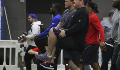 Buffalo Bills defensive tackle Kyle Williams works out during the first day of voluntary off season conditioning, Monday, April 3, 2017, in Orchard Park, N.Y. (AP Photo/Jeffrey T. Barnes)