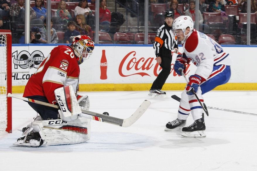 Florida Panthers goaltender Reto Berra (20) stops a shot by Montreal Canadiens left wing Artturi Lehkonen (62) during the second period of an NHL hockey game, Monday, April 3, 2017, in Sunrise, Fla. (AP Photo/Joel Auerbach)