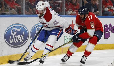 Montreal Canadiens center Paul Byro (41) and Florida Panthers center Derek MacKenzie (17) battle for control of the puck behind the net during the second period of an NHL hockey game, Monday, April 3, 2017, in Sunrise, Fla. (AP Photo/Joel Auerbach)