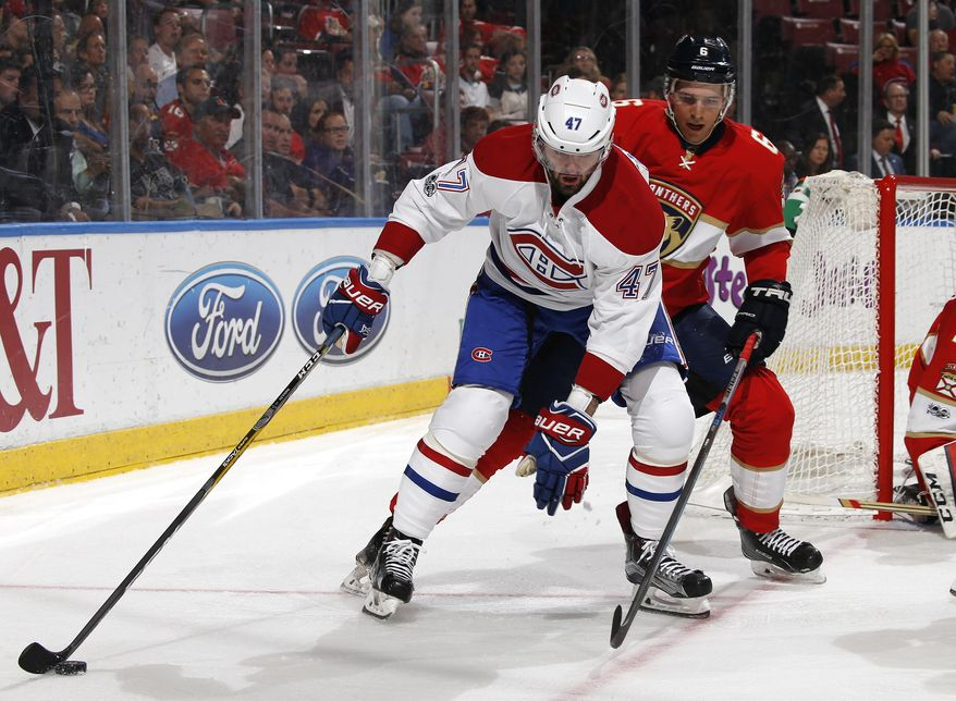 Florida Panthers defenseman Alex Petrovic (6) defends against Montreal Canadiens right wing Alexander Radulov (47) as he skates with the puck during the second period of an NHL hockey game, Monday, April 3, 2017, in Sunrise, Fla. (AP Photo/Joel Auerbach)