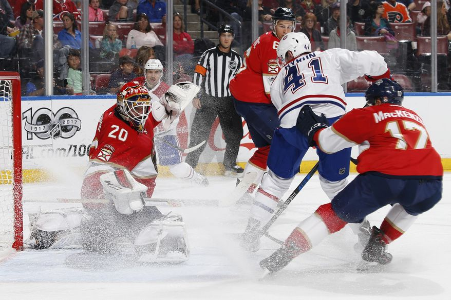 Florida Panthers goaltender Reto Berra (20) stops a shot by Montreal Canadiens center Paul Byro (41) during the second period of an NHL hockey game, Monday, April 3, 2017, in Sunrise, Fla. (AP Photo/Joel Auerbach)