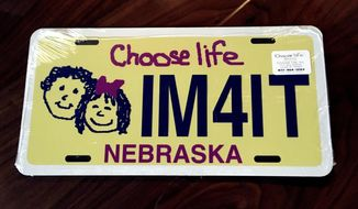 A sample Choose Life Nebraska license plate is seen in Lincoln on Monday, April 3, 2017. The plates will be available Jan. 1, 2018, under a bill passed Monday by the Legislature and expected to be signed by Gov. Pete Ricketts. (AP Photo/Julia Shumway)