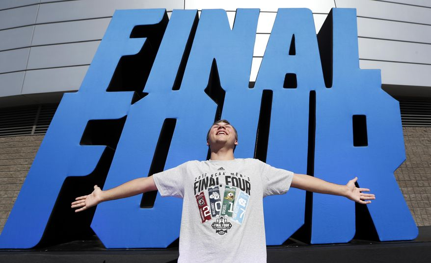 Keenan Rowein, of Edmonton, Alberta, poses for a photo outside of University of Phoenix Stadium before the Final Four NCAA college basketball tournament championship game between North Carolina and Gonzaga, Monday, April 3, 2017, in Glendale, Ariz. (AP Photo/Charlie Neibergall)