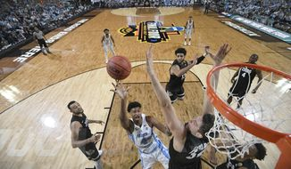 North Carolina's Isaiah Hicks (4) takes a shot over Gonzaga's Zach Collins (32) during the first half in the finals of the Final Four NCAA college basketball tournament, Monday, April 3, 2017, in Glendale, Ariz. (AP Photo/Chris Steppig, Pool)