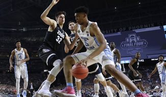 North Carolina forward Tony Bradley (5) drives past Gonzaga forward Zach Collins (32) during the second half in the finals of the Final Four NCAA college basketball tournament, Monday, April 3, 2017, in Glendale, Ariz. (AP Photo/David J. Phillip)