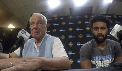 North Carolina head coach Roy Williams, left, and Joel Berry II participate in a news conference for the Final Four NCAA college basketball tournament, Sunday, April 2, 2017, in Glendale, Ariz. (AP Photo/Tim Donnelly)