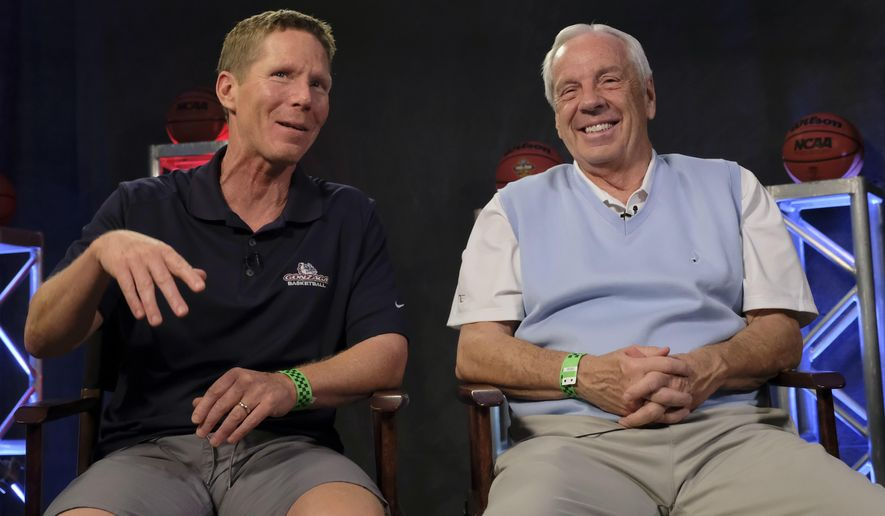 Gonzaga head coach Mark Few, left, talks to North Carolina head coach Roy Williams during the CBS Sports Network interview for the Final Four NCAA college basketball tournament, Sunday, April 2, 2017, in Glendale, Ariz. (AP Photo/David J. Phillip)
