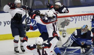 United States forward Hilary Knight (21) and teammates celebrate her goal on Finland goalie Noora Raty during the first period of a IIHF Women's World Championship hockey tournament game, Monday, April 3, 2017, in Plymouth, Mich. (AP Photo/Carlos Osorio)