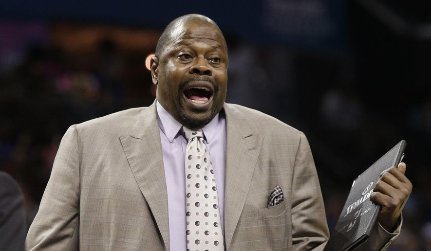 FILE - In this April 13, 2015, file photo, Charlotte Hornets assistant coach Patrick Ewing argues a call during the second half of an NBA basketball game against the Houston Rockets in Charlotte, N.C. A person with direct knowledge of the situation says former Georgetown star Patrick Ewing has been hired to coach the school's basketball team, more than two decades after he led the Hoyas to their only national championship as a player. The person spoke to The Associated Press on condition of anonymity because the school has not announced the hire. (AP Photo/Chuck Burton, File)