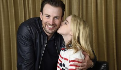 "In this March 23, 2017 photo, Chris Evans, left, and McKenna Grace, cast members in the film ""Gifted,"" pose for a portrait at the Four Seasons Hotel in Los Angeles. Evans stars as a single guy raising his math-prodigy niece, played by Grace. (Photo by Chris Pizzello/Invision/AP)"