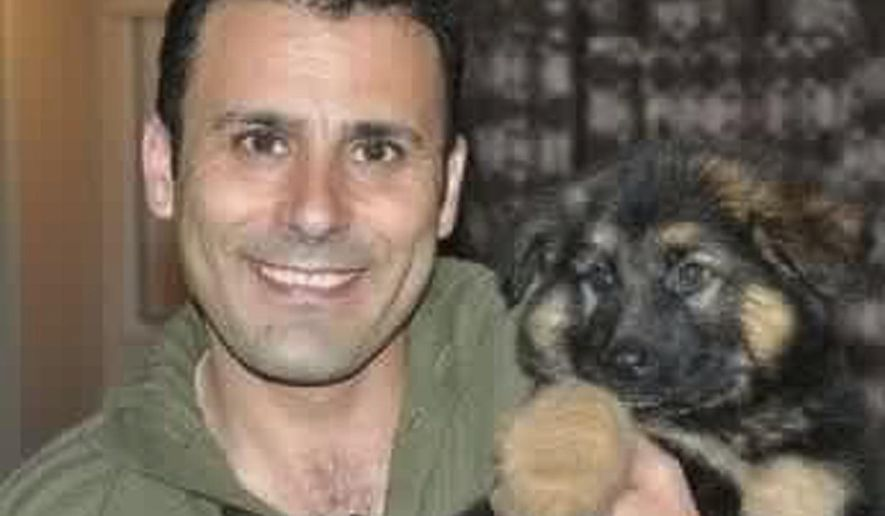 """FILE - In this undated file photo released by the """"Bring Robin Home"""" Facebook page on Wednesday, Oct. 26, 2016, Robin Shahini poses in front of a camera. The Iranian-American held in Tehran reportedly had been sentenced to 18 years in prison. Activists say the Iranian-American who has been serving an 18-year prison sentence for """"collaboration with a hostile government"""" has been released on bail. (Robin Shahini via AP, File)"""