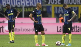 From left, Inter Milan's Geoffrey Kondogbia, Joao Miranda and Mauro Icardi react after Sampdoria's Fabio Quagliarella scored the 2-1 goal, during a Serie A soccer match between Inter Milan and Sampdoria, at the San Siro stadium in Milan, Italy, Monday, April 3, 2017. (AP Photo/Antonio Calanni)