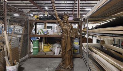 In a Friday, March 31, 2017 photo, Lincoln's replica of the Statue of Liberty sits refurbished in the Parks and Recreation Maintenance facility, awaiting it's reinstallation in Antelope Park's Veterans Memorial Garden in Lincoln, Neb. (Ted Kirk/The Journal-Star via AP)