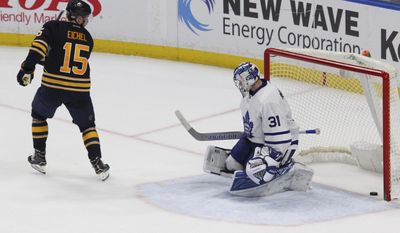 Buffalo Sabres forward Jack Eichel (15) puts the puck past Toronto Maple Leafs goalie Frederik Andersen (31) during the third period of an NHL hockey game, Monday, April 3, 2017, in Buffalo, N.Y. (AP Photo/Jeffrey T. Barnes)