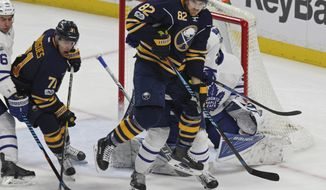 Buffalo Sabres forward Marcus Foligno (82) crashes the net during the third period of an NHL hockey game against the Toronto Maple Leafs, Monday, April 3, 2017, in Buffalo, N.Y. (AP Photo/Jeffrey T. Barnes)