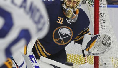 Buffalo Sabres goalie Anders Nilsson (31) keeps his eyes on the puck during the second period of an NHL hockey game against the Toronto Maple Leafs, Monday, April 3, 2017, in Buffalo, N.Y. (AP Photo/Jeffrey T. Barnes)