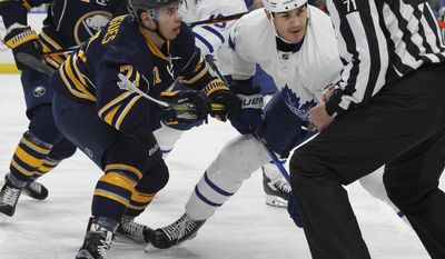 Buffalo Sabres Evan Rodrigues (71) takes the draw against Toronto Maple Leafs Brian Boyle (24) during the first period of an NHL hockey game, Monday, April 3, 2017, in Buffalo, N.Y. (AP Photo/Jeffrey T. Barnes)