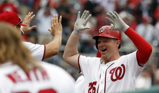 Washington Nationals pinch hitter Adam Lind (26) celebrates his two-run homer during the seventh inning of an opening day baseball game against the Miami Marlins, at Nationals Park, Monday, April 3, 2017, in Washington. (AP Photo/Alex Brandon)