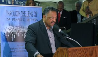 The Rev. Jesse Jackson speaks at the unveiling of a historical marker at Memphis International Airport commemorating the final flight of slain civil rights leader Martin Luther King Jr. on Monday, April 3, 2017, in Memphis, Tenn. (AP Photo/Adrian Sainz) ** FILE **