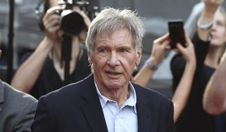Harrison Ford greets fans during a Star Wars fan event in Sydney, Australia, Dec. 10, 2015. Ford's attorney said Monday, April 3, 2017, that the FAA had concluded its investigation into the actor landing on the wrong runway at a Southern California airport, and would take no actions against his pilot license or issue any fines against him. (AP Photo/Rob Griffith) ** FILE **