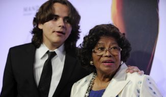 "In this June 29, 2013, file photo, Prince Jackson, left, and Katherine Jackson arrive at the world premiere of ""Michael Jackson ONE"" at THEhotel at Mandalay Bay Resort and Casino in Las Vegas. Prince Jackson unveiled a tattoo tribute to his late father, Michael, in an Instagram post on March 31, 2017. (Photo by David Becker/Invision/AP, File)"