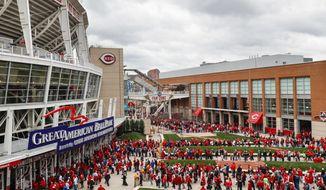 Spectators wait in line to enter Great American Ballpark before a baseball game between the Cincinnati Reds and the Philadelphia Phillies, Monday, April 3, 2017, in Cincinnati. (AP Photo/John Minchillo) **FILE**