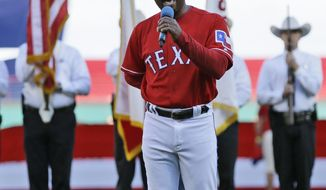 Texas Rangers third base coach Tony Beasley sings the national anther before an opening day baseball against the Cleveland Indians game in Arlington, Texas, Monday, April 3, 2017. (AP Photo/LM Otero)