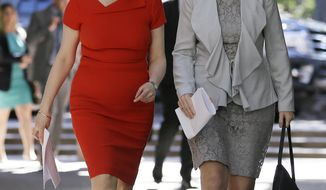 Scotland's First Minister Nicola Sturgeon, left, walks with Lena Wilson, CEO of Scottish Enterprise, to a round table discussion at the Quadrus Conference Center Monday, April 3, 2017, in Menlo Park, Calif. Sturgeon took part in a round table discussion with angel investors led by Investing Women to help connect Scottish female entrepreneurs to US investors and vice versa. (AP Photo/Eric Risberg)