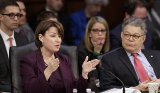 Democratic members of the Senate Judiciary Committee, Sen. Amy Klobuchar, D-Minn., left, and Sen. Al Franken, D-Minn., question the Republican side as the panel meets to advance the nomination of President Donald Trump's Supreme Court nominee Neil Gorsuch, Monday, April 3, 2017, on Capitol Hill in Washington. (AP Photo/J. Scott Applewhite) ** FILE **