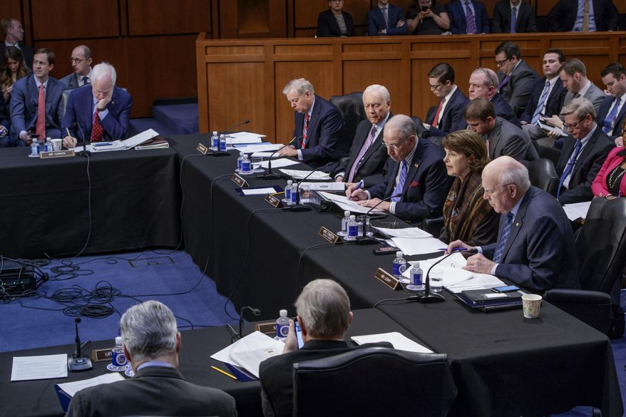 The Senate Judiciary Committee meets to advance the nomination of President Donald Trump's Supreme Court nominee Neil Gorsuch to fill the vacancy left by the late Antonin Scalia, Monday, April 3, 2017, on Capitol Hill in Washington. Top, from left are, Sen. John Cornyn, R-Texas, Sen. Lindsey Graham, R-S.C., Sen. Orrin Hatch, R-Utah, Committee Chairman Sen. Charles Grassley, R-Iowa, the Committee's ranking member Sen. Dianne Feinstein, D-Calif. and Sen. Patrick Leahy, D-Vt. (AP Photo/J. Scott Applewhite)