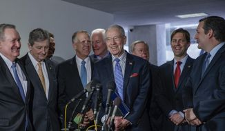 Senate Judiciary Committee Chairman Sen. Charles Grassley, R-Iowa (center) and Sen. John Cornyn, R-Texas, unveil an immigration plan that would eliminate the Diversity Visa Lottery and reuse those visas to lower the existing immigration backlog. (AP file photo)