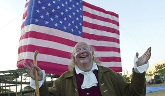 FILE – In this July 3, 2002, file photo, re-enactor Ralph Archbold, portraying Benjamin Franklin, waits to board the world's largest U.S. flag-shaped hot air balloon, during an event marking the one-year countdown to the opening of the National Constitution Center under construction on Independence Mall in Philadelphia. Archbold, who portrayed Franklin in Philadelphia for more than 40 years, died Saturday, March 25, 2017, at age 75, according to the Alleva Funeral Home in Paoli, Pa. (AP Photo/Brad C Bower, File)