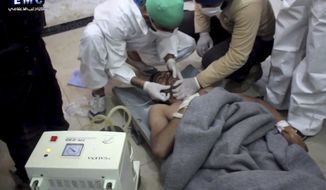 This frame grab from video provided on Tuesday April 4, 2017, by the Syrian anti-government activist group Edlib Media Center, that is consistent with independent AP reporting, shows a victim of a suspected chemical attack as he receives treatment at a makeshift hospital, in the town of Khan Sheikhoun, northern Idlib province, Syria. The suspected chemical attack killed dozens of people on Tuesday, Syrian opposition activists said, describing the attack as among the worst in the country's six-year civil war. (Edlib Media Center, via AP)