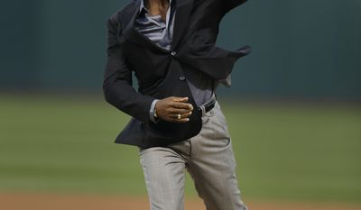 Former Oakland Athletic and Baseball Hall of Fame inductee Rickey Henderson throws out the ceremonial first pitch on the newly dedicated Rickey Henderson field prior to the baseball game against the Los Angeles Angels Monday, April 3, 2017, in Oakland, Calif. (AP Photo/Ben Margot)