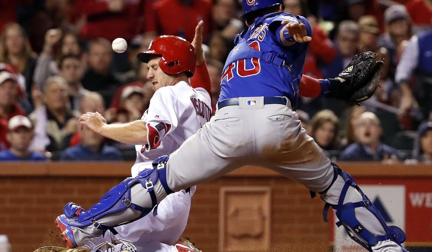 St. Louis Cardinals' Stephen Piscotty, left, is hit in the head with the ball while scoring as the throw gets past Chicago Cubs catcher Willson Contreras during the fifth inning of a baseball game Tuesday, April 4, 2017, in St. Louis. (AP Photo/Jeff Roberson)