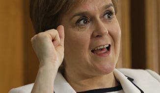 """Scotland's First Minister Nicola Sturgeon gestures during a question and answer period after speaking at Stanford University Tuesday, April 4, 2017, in Stanford, Calif. Sturgeon delivered a speech about """"Scotland's Place in the World"""" before heading to New York. (AP Photo/Eric Risberg)"""