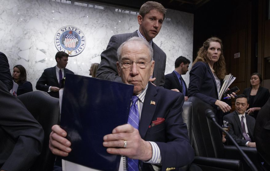Senate Judiciary Committee Chairman Sen. Charles Grassley, R-Iowa, wraps up the meeting on Capitol Hill in Washington, Monday, April 3, 2017, after his panel voted along party lines on the nomination of President Donald Trump's Supreme Court nominee Neil Gorsuch. (AP Photo/J. Scott Applewhite)