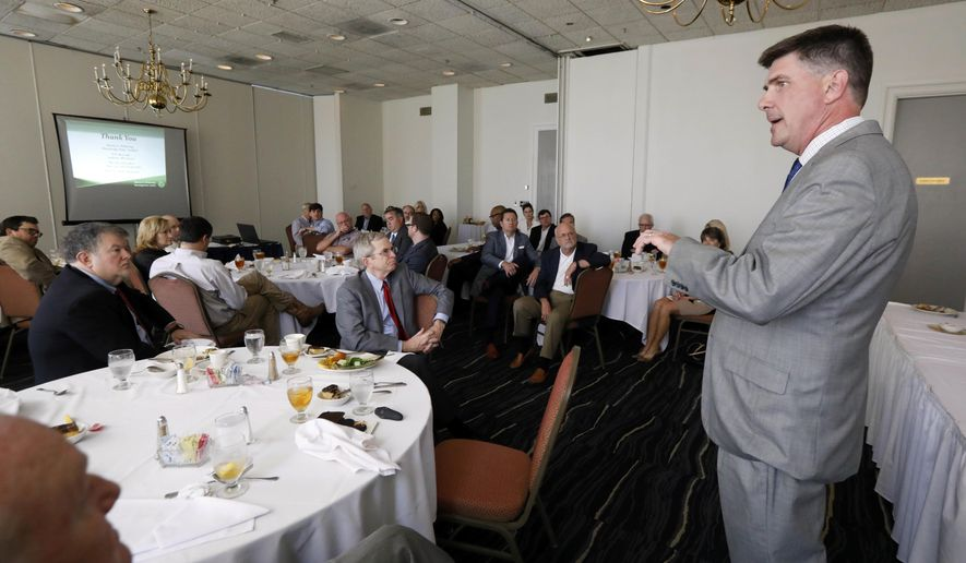 Speaking before the Stennis Institute luncheon in Jackson, Miss., Republican State Auditor Stacey Pickering says his office has found pornography and other explicit material on computers that some public schools issued to middle school and high school students, Tuesday, April 4, 2017. In a report issued Tuesday afternoon, Pickering recommends that the state Department of Education require all school districts to monitor school-issued laptops or tablets when the electronic devices are off-campus. (AP Photo/Rogelio V. Solis)