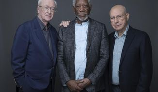 "In this March 27, 2017 photo, actors Michael Caine, Morgan Freeman and Alan Arkin pose for a portrait to promote their new film ""Going in Style"" in New York. (Photo by Amy Sussman/Invision/AP)"