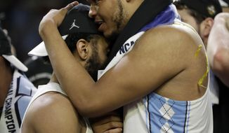 sNorth Carolina's Kennedy Meeks, right, celebrates with his teammate after the finals of the Final Four NCAA college basketball tournament against Gonzaga, Monday, April 3, 2017, in Glendale, Ariz. North Carolina won 71-65. (AP Photo/David J. Phillip)