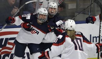 United States forward Hannah Brandt (20) celebrates her goal with forwards Gigi Marvin (19) and Meghan Duggan (10), during the third period of a IIHF Women's World Championship hockey tournament game against Finland, Monday, April 3, 2017, in Plymouth, Mich. The United States won 5-3. (AP Photo/Carlos Osorio)