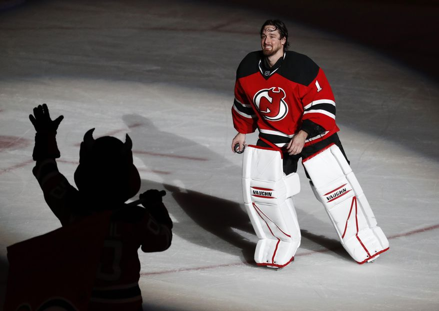 New Jersey Devils goalie Keith Kinkaid takes a curtain call after recording a 1-0 overtime win over the Philadelphia Flyers in an NHL hockey game, Tuesday, April 4, 2017, in Newark, N.J. (AP Photo/Julio Cortez)