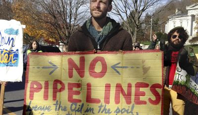 FILE - In this Oct. 24, 2015 file photo, demonstrators protest in Montpelier, Vt., a natural gas pipeline by Vermont Gas Systems through the western part of the state. The state Supreme Court will hear arguments Tuesday, April 4, 2017, whether the pipeline should be allowed to run under a public park in the town of Hinesburg. If the company loses, it has agreed to remove that section which already has been laid beneath Geprags Park. (AP Photo/Lisa Rathke, File)
