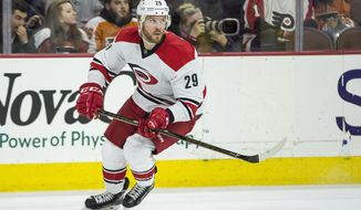FILE - In this Oct. 22, 2016, file photo, Carolina Hurricanes' Bryan Bickell skates during the first period of an NHL hockey game against Philadelphia Flyers, in Philadelphia. Bickell has rejoined the Hurricanes for the last few games of the regular season, five months after his diagnosis of multiple sclerosis forced a hiatus from the team and raised questions about his future in the sport. Bickell skated with the Hurricanes on Tuesday morning, April 4, 2017, in Minnesota and was slated for the lineup to face the Wild at night. (AP Photo/Chris Szagola, File)