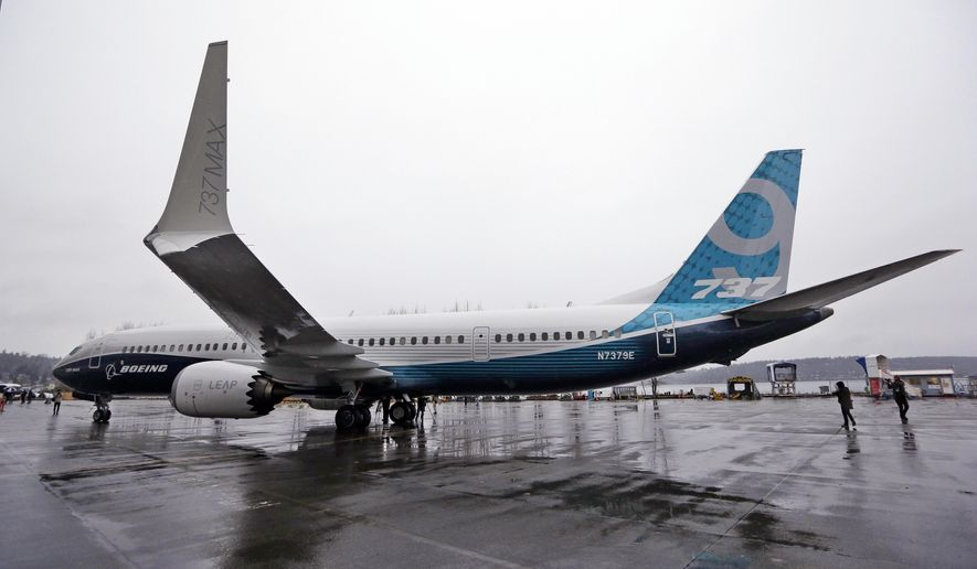 In this March 7, 2017, file photo, the first of the large Boeing 737 MAX 9 models, Boeing's newest commercial airplane, sits outside its production plant, in Renton, Wash. Boeing Co. announced Tuesday, April 4, 2017, that it has signed a new, $3 billion deal with Iran's Aseman Airlines for 30 Boeing 737 MAX aircraft. Chicago-based Boeing said the deal includes purchase rights for an additional 30 737 MAX aircraft. (AP Photo/Elaine Thompson, File )