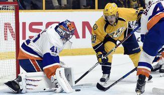 New York Islanders goalie Jaroslav Halak (41), of Slovakia, blocks a shot by Nashville Predators left wing Viktor Arvidsson (38), of Sweden, during the second period of an NHL hockey game Tuesday, April 4, 2017, in Nashville, Tenn. (AP Photo/Mark Zaleski)