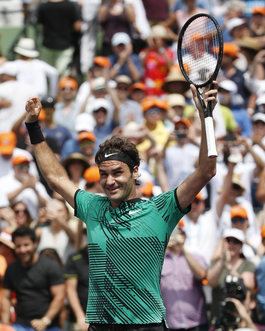 Roger Federer, of Switzerland, smiles after defeating Rafael Nadal, of Spain, 6-3, 6-4 during the men's final at the Miami Open tennis tournament Sunday, April 2, 2017, in Key Biscayne, Fla. (AP Photo/Wilfredo Lee)