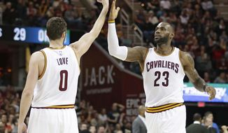 Cleveland Cavaliers' Kevin Love (0) and LeBron James (23) celebrate in the second half of an NBA basketball game against the Orlando Magic, Tuesday, April 4, 2017, in Cleveland. The Cavaliers won 122-102. (AP Photo/Tony Dejak)